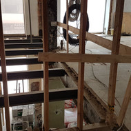 The framework is being done on the Mezzanine floor, making it into a residential floor, rather than being open and looking down onto the main floor.