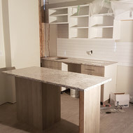Counters and Cabinetry being installed in an 02 unit.
