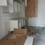 Cabinetry being installed in a studio suite.