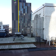 The rooftop patio and BBQ pre-renovation.