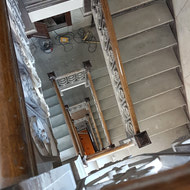 Around and around and around we go! Can't wait to see this staircase refurbished with it's historical elements preserved!