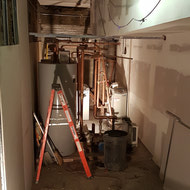 One of the utility rooms under construction in the basement.