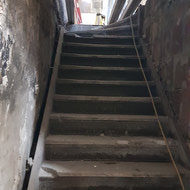 Old staircase in the back of the building connecting the old store to the main basement area.