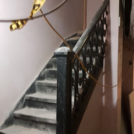 The old staircase with original iron spindles.
